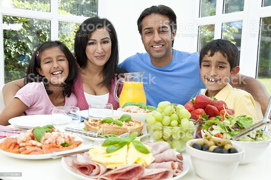 Asian Indian Parents Children Family Eating Healthy Food stock photo