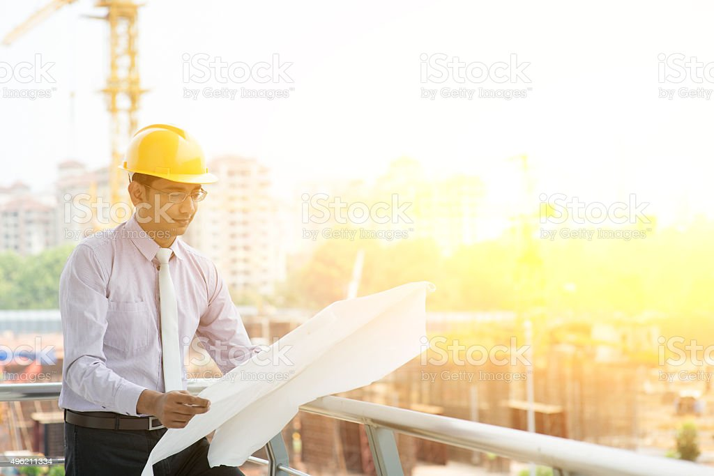 Asian Indian site contractor engineer working stock photo
