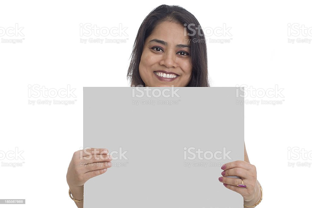 Asian Indian Woman showing blank signboard, isolated royalty-free stock photo