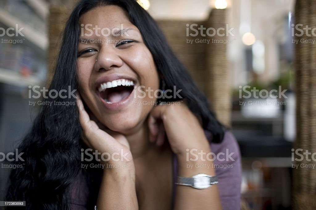 Asian Indian Young Woman Laughing in Cafe, Copy Space royalty-free stock photo
