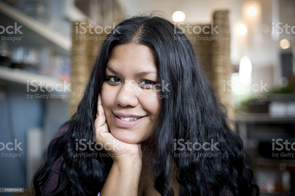 Asian Indian Young Woman Portrait, Smiling in Cafe, Natural Light royalty-free stock photo