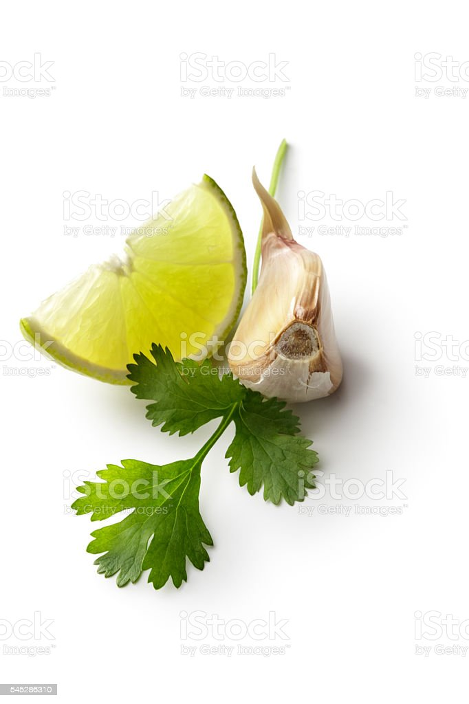 Asian Ingredients: Lime, Cilantro and Garlic Isolated on White Background stock photo