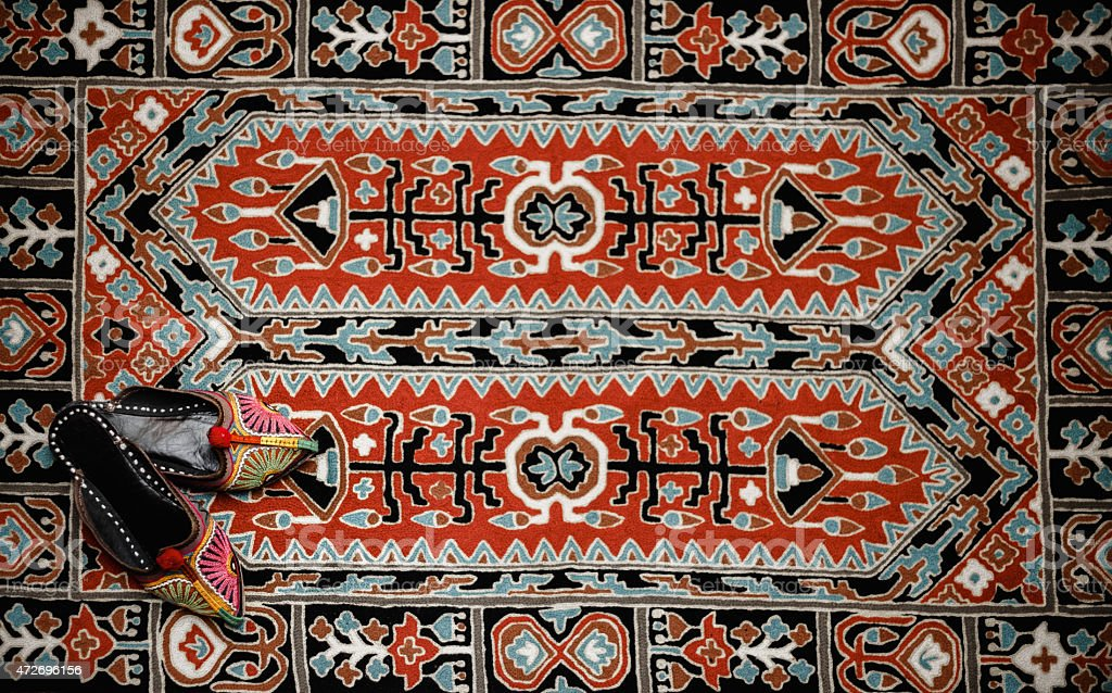 Asian interior. Carpet and slippers stock photo