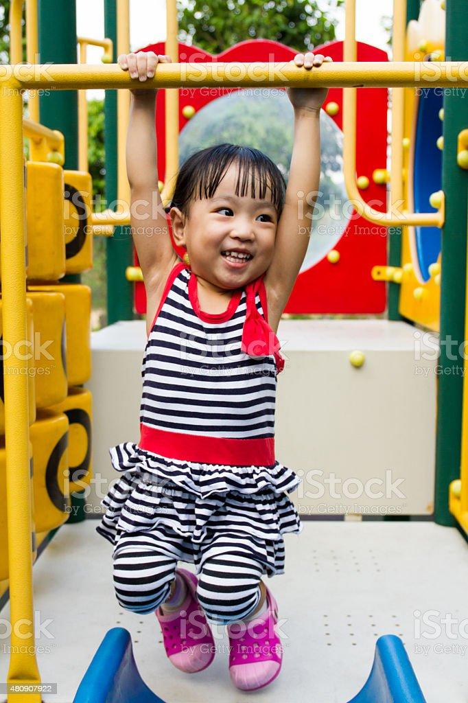 Asian Kid Hanging on bar stock photo
