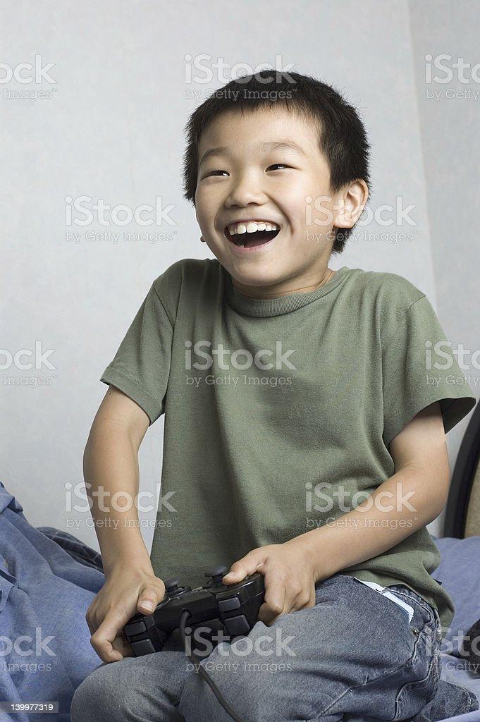 asian kid playing game royalty-free stock photo