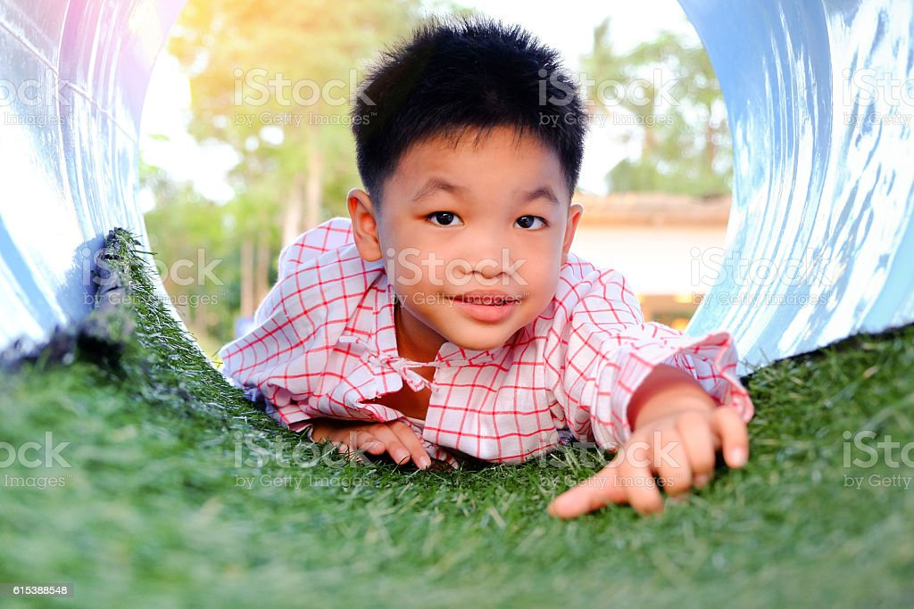 Asian kid playing stock photo