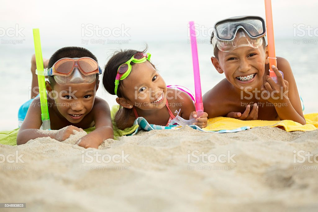 Asian kids at the beach stock photo