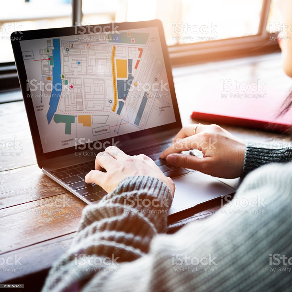 Asian Lady Looking at City Map Plan Concept stock photo