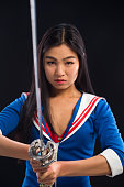 Asian lady with sword in studio