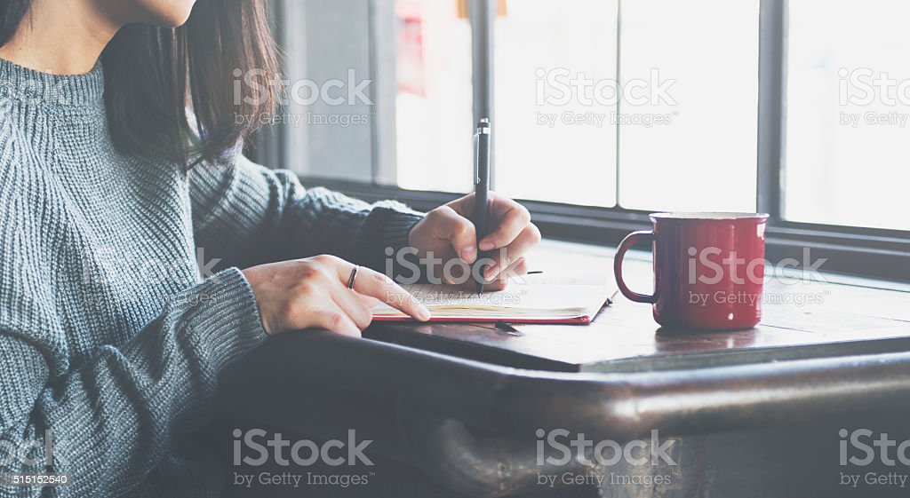 Asian Lady Writing Notebook Diary Concept stock photo