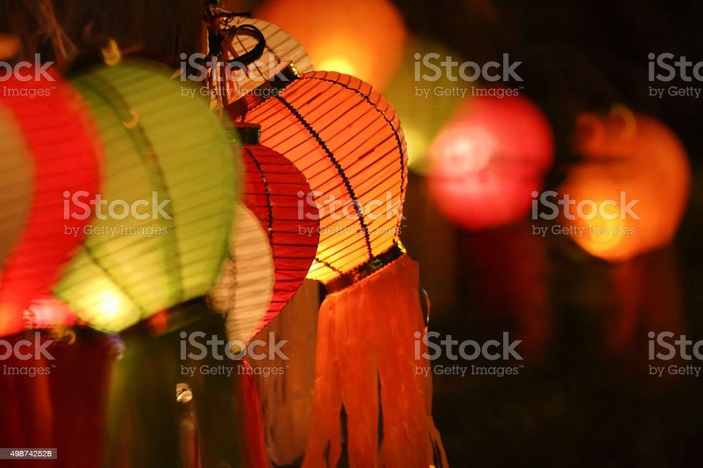Asian lanterns on fence stock photo
