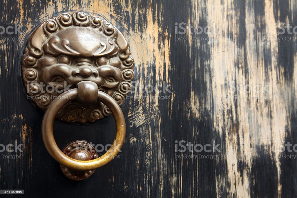 Asian Lion Door Knocker on Black Background royalty-free stock photo