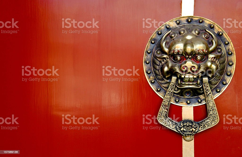 Asian Lion Door Knocker on Red Background royalty-free stock photo