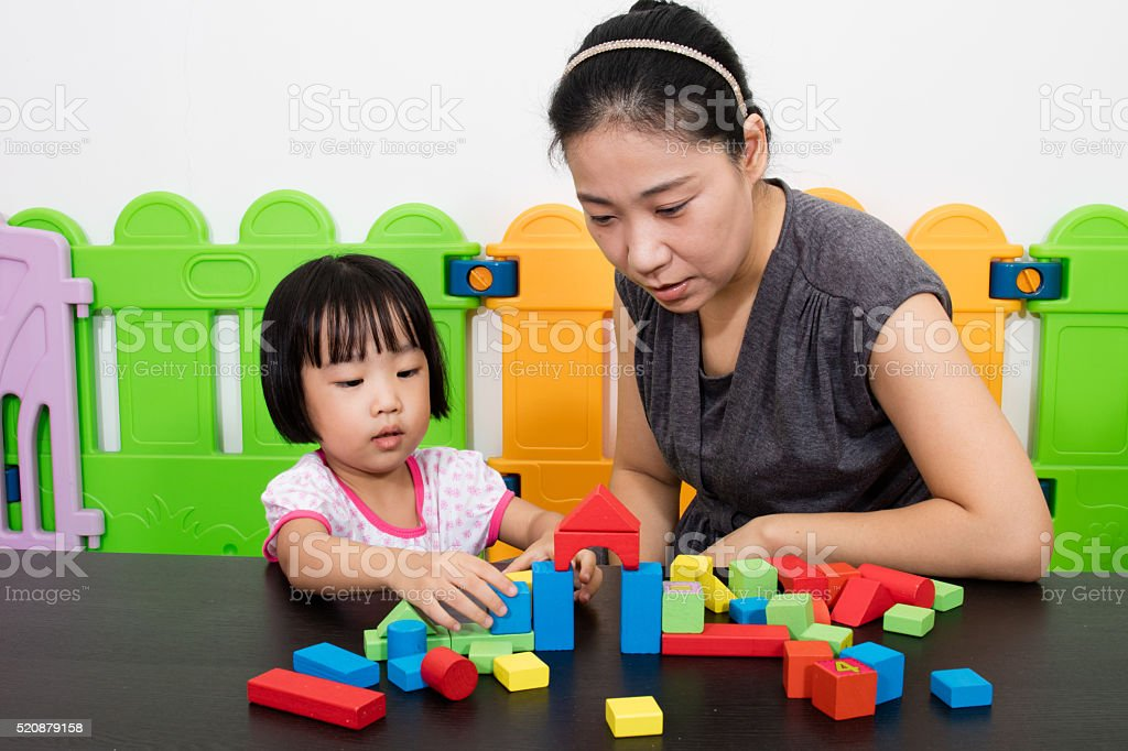 Asian Little Chinese Girl and Mother Playing Together stock photo