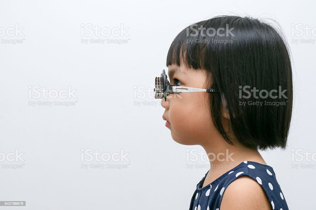 Asian Little Chinese Girl Doing Eyes Examination stock photo