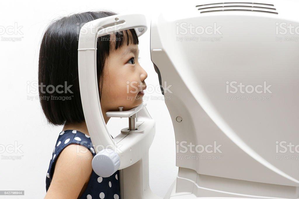 Asian Little Chinese Girl Doing Eyes Examination Through Auto re stock photo