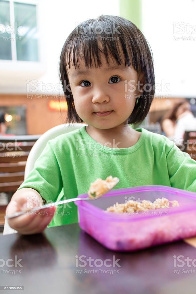 Asian Little Chinese Girl Eating Fried Rice stock photo