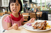 Asian Little Chinese Girl Eating Western Food