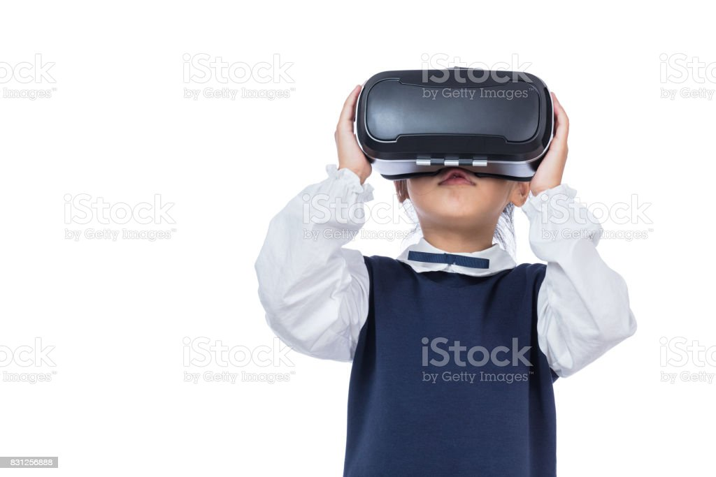Asian little Chinese girl experiencing virtual reality via VR goggles stock photo