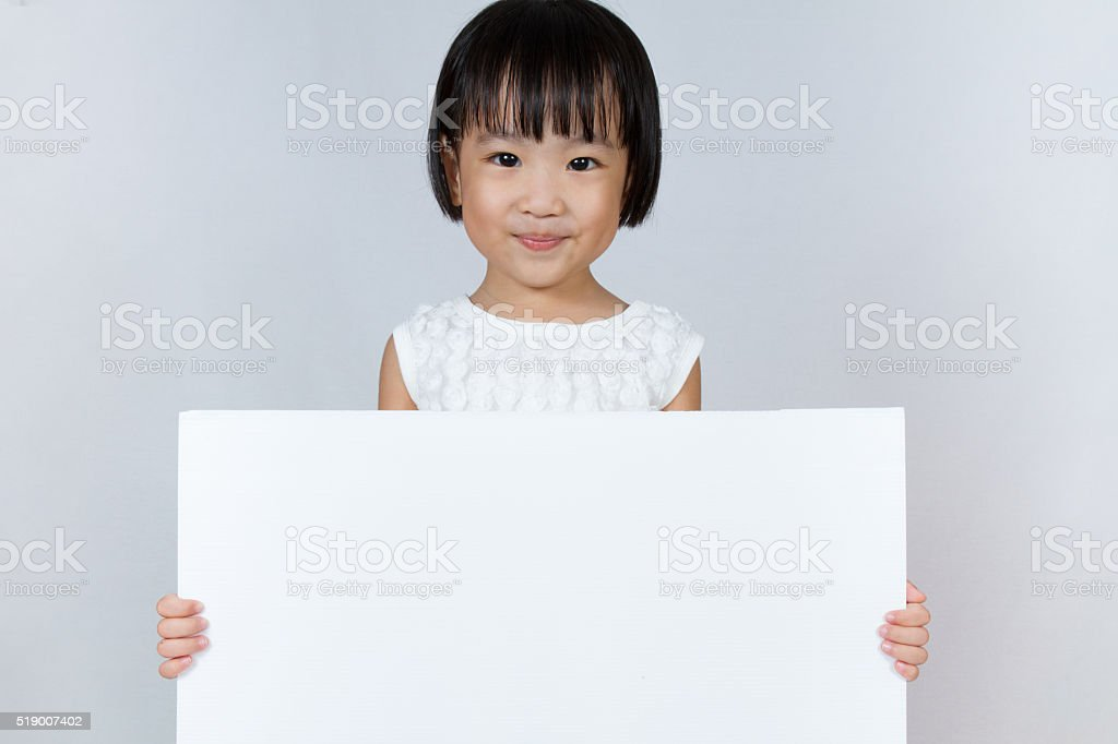 Asian Little Chinese Girl Holding a White Blank stock photo