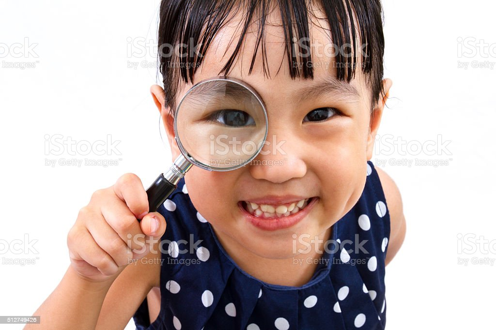 Asian Little Chinese Girl Holding Magnifying Glass stock photo