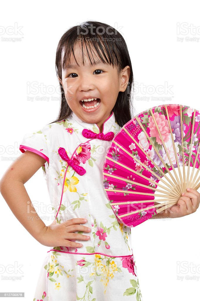 Asian Little Chinese Girl Holding Oriental Fan stock photo