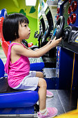 Asian Little Chinese Girl Playing Arcade Game Machine