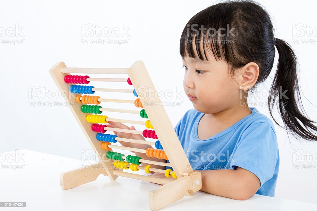 Asian Little Chinese Girl Playing Colorful Abacus stock photo