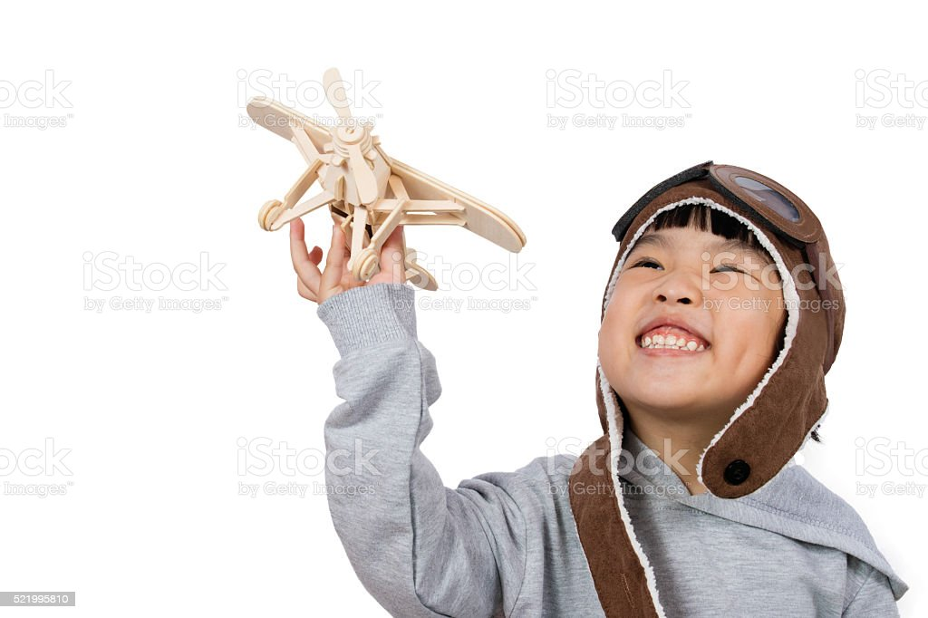 Asian Little Chinese Girl Playing with Toy Airplane stock photo