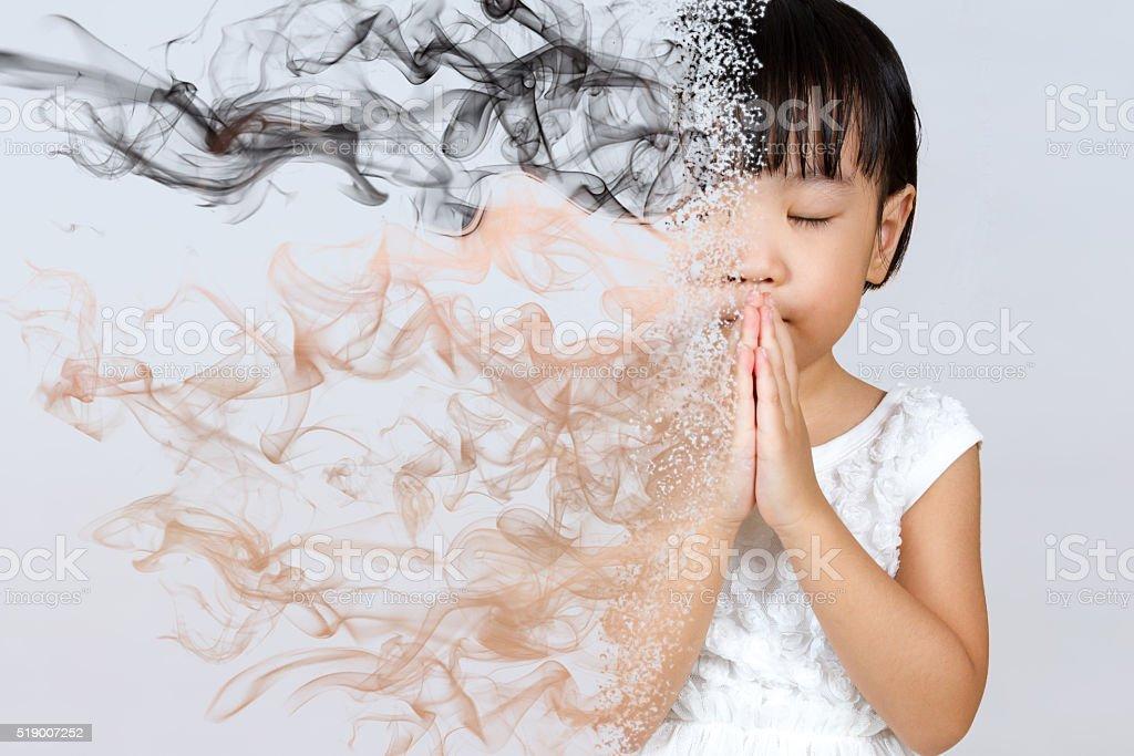 Asian Little Chinese Girl Praying stock photo