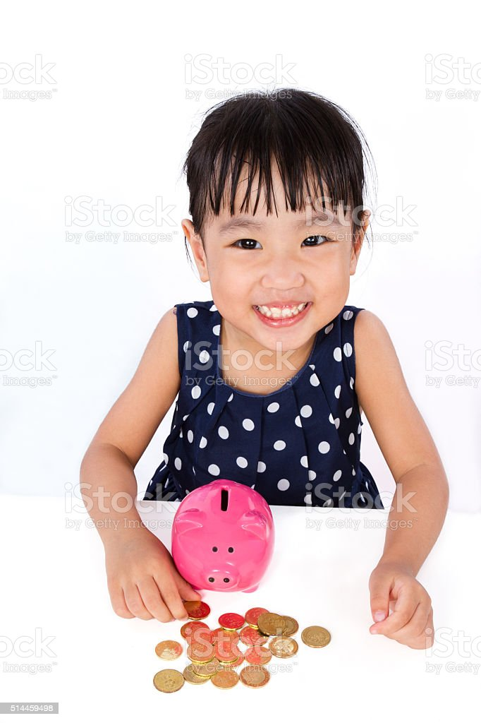 Asian Little Chinese Girl Saving Money in a Piggy Bank stock photo