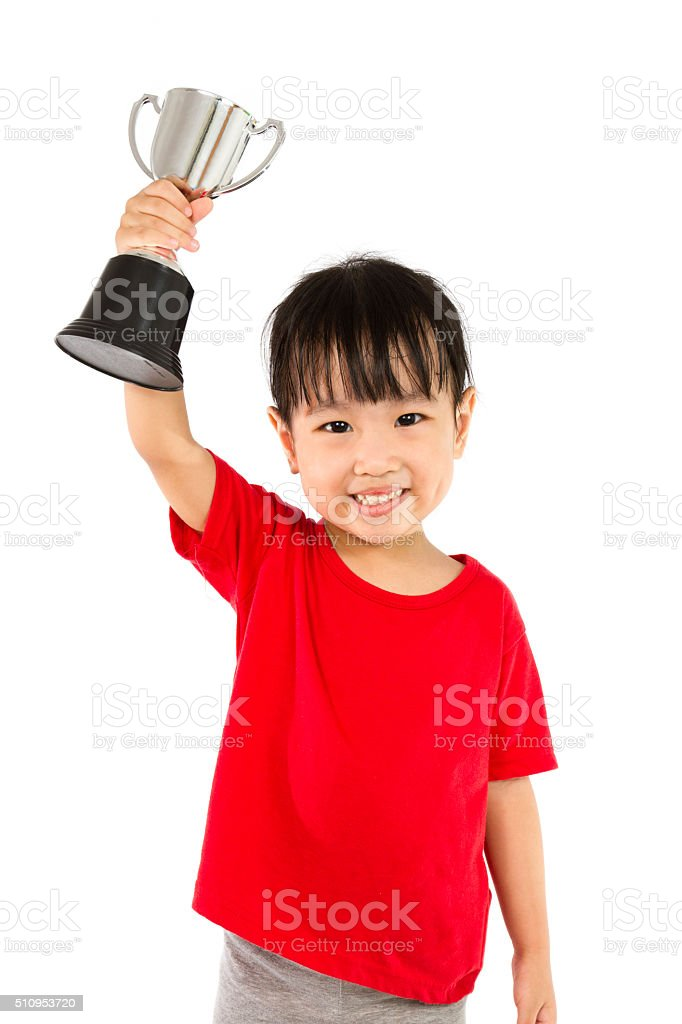 Asian Little Chinese Girl Smiles with a Trophy stock photo