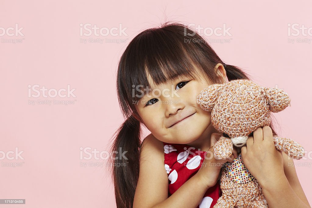 Asian little girl and stuffed animal stock photo