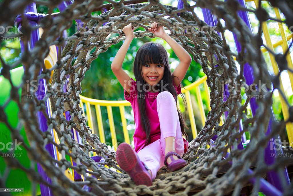 Asian little girl enjoys royalty-free stock photo
