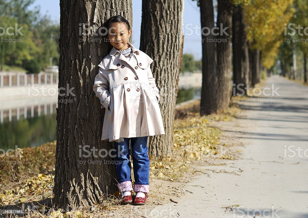 Asian little girl in autumn royalty-free stock photo