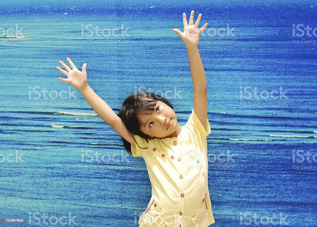 Asian little girl on blue background royalty-free stock photo