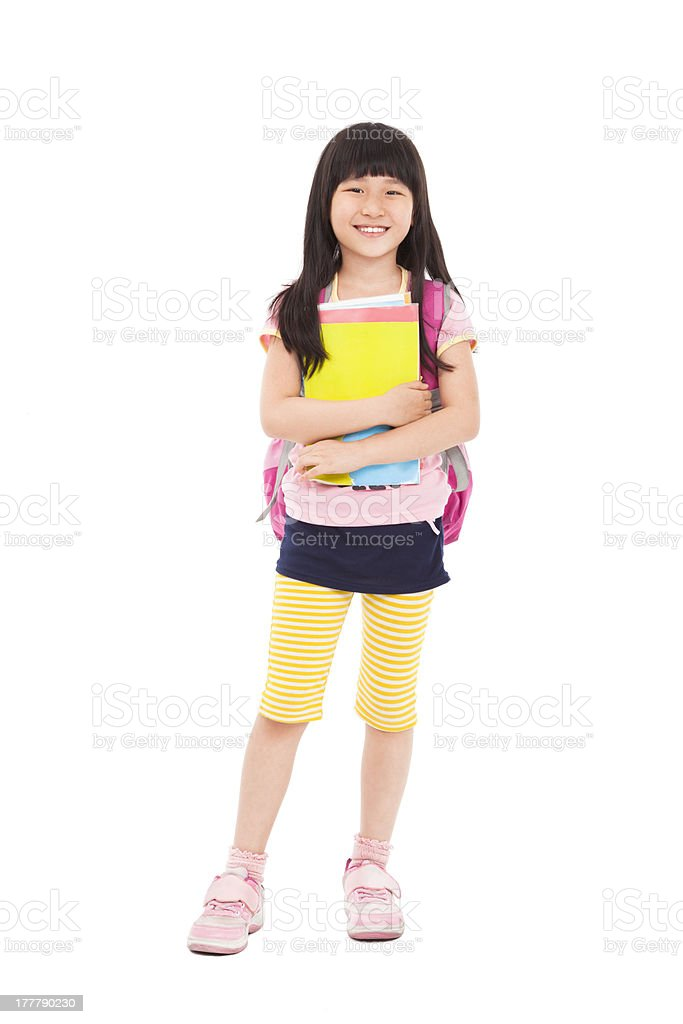 asian little girl standing and holding books stock photo