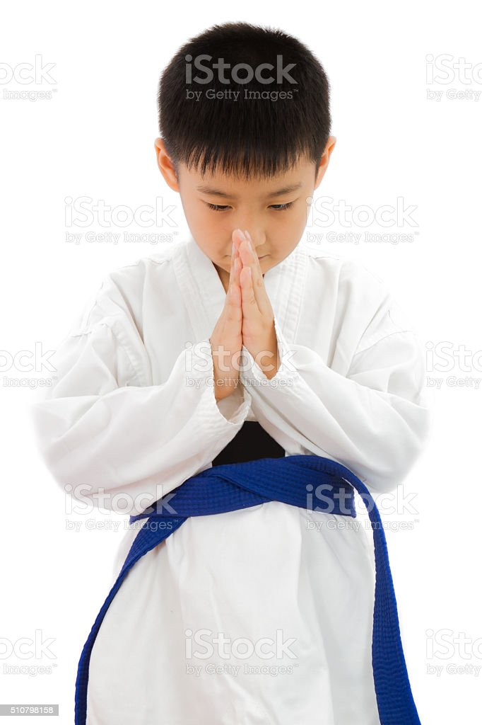 Asian Little Karate Boy in White Kimono stock photo