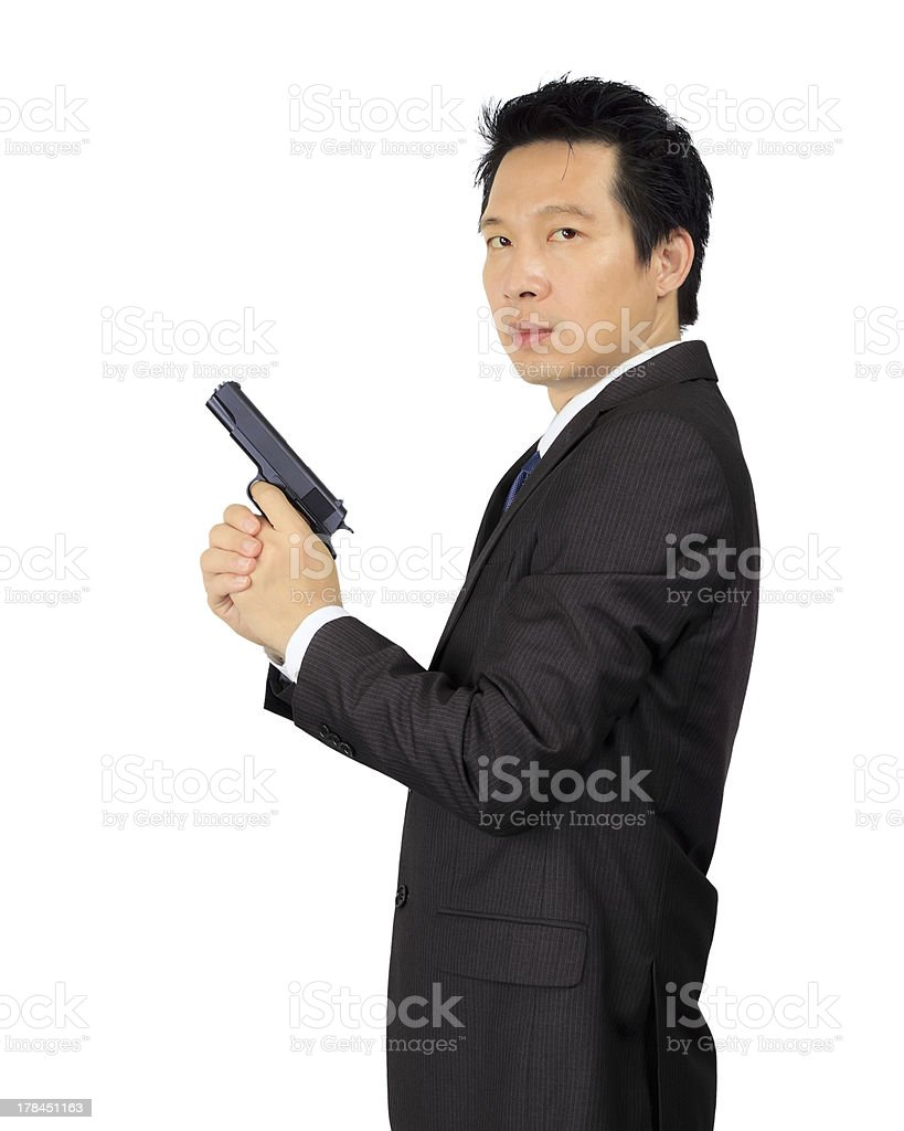 Asian male carry a gun on white royalty-free stock photo