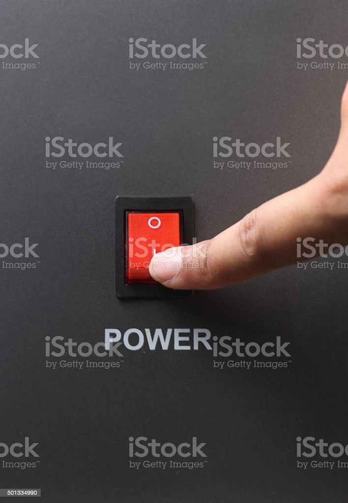 Asian male hand turning on red power switch stock photo