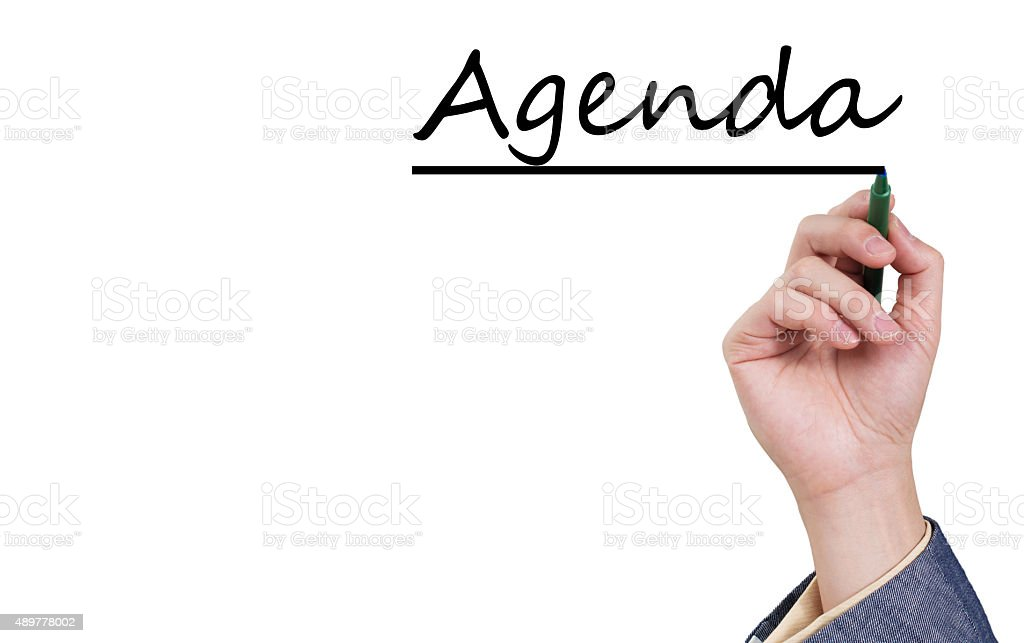 Asian male hand writing agenda on white board stock photo