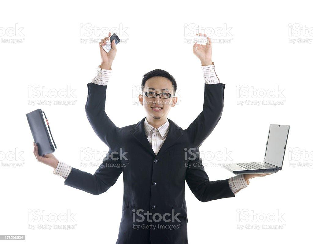 asian male multitasking stock photo