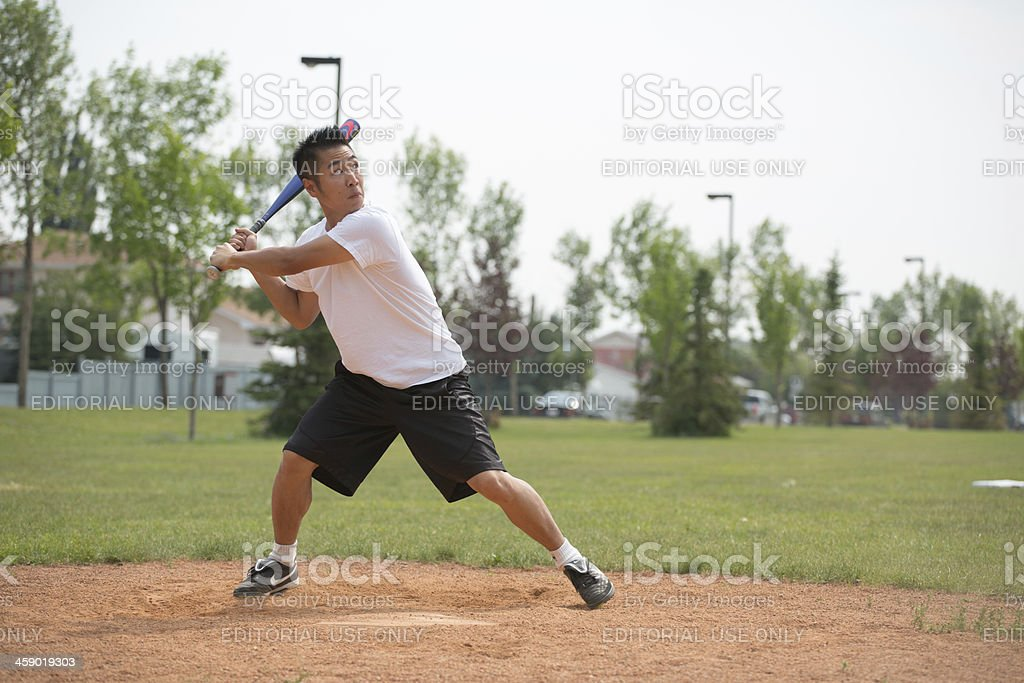 \'Edmonton, Canada - July 14, 2012: Man batting at softball...