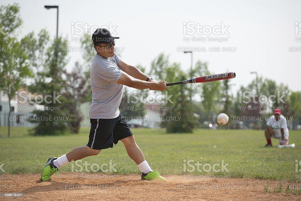 \'Edmonton, Canada - July 14, 2012: Man batting at softball...