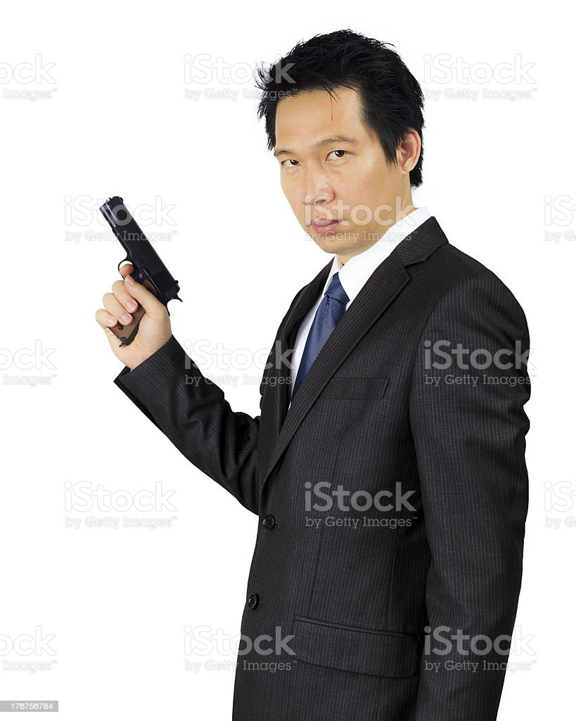 Asian male with a gun on white royalty-free stock photo