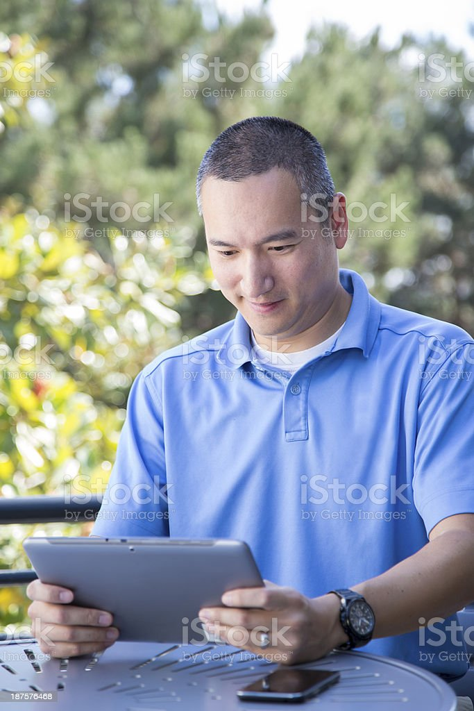 Asian Male with Tablet and Cell Phone royalty-free stock photo