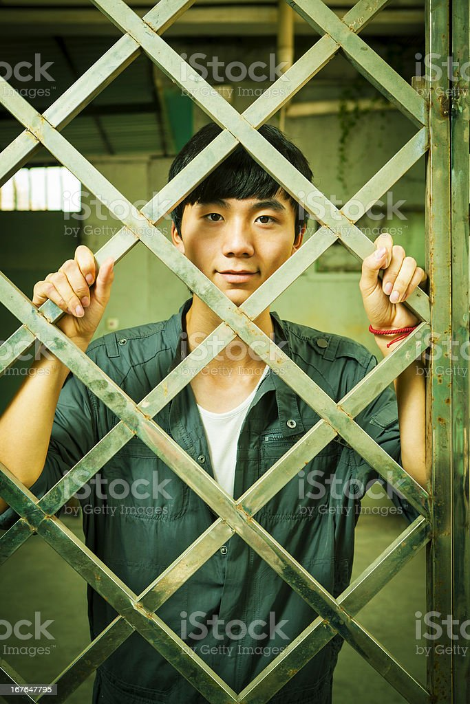 Asian man behind fence royalty-free stock photo