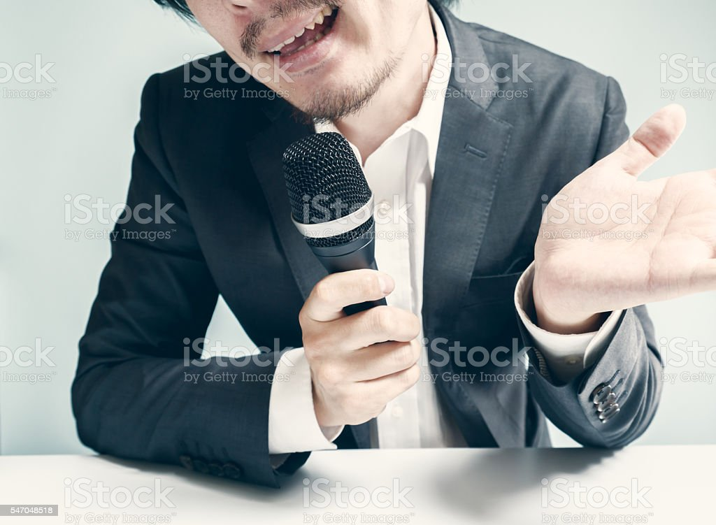 Asian man commenting stock photo