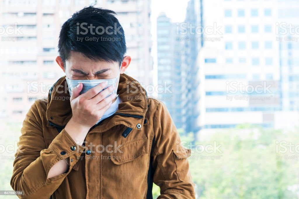 Asian man feeling unwell at outdoor stock photo
