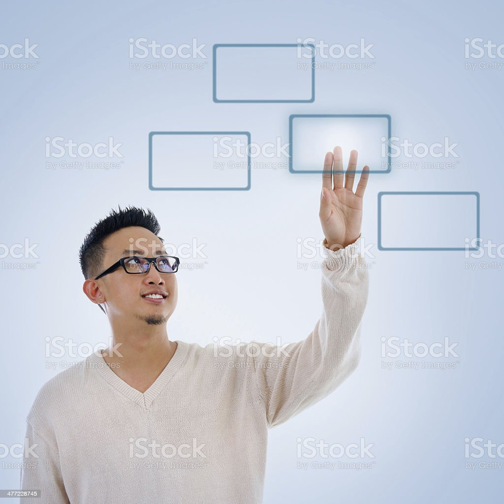 Asian man finger pressing on touch screen monitor button stock photo